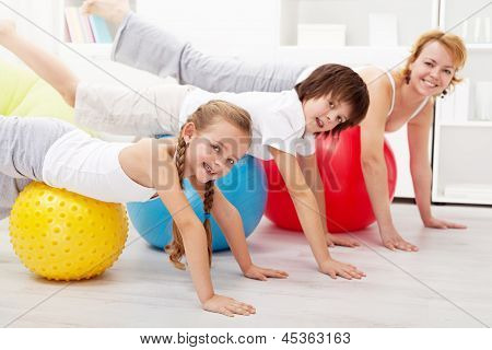 Healthy People Doing Balancing Exercise At Home