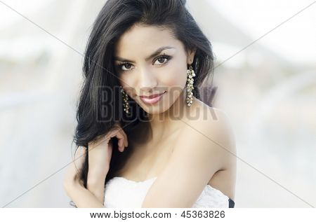 Portrait of a beautiful exotic young woman with long dark hair