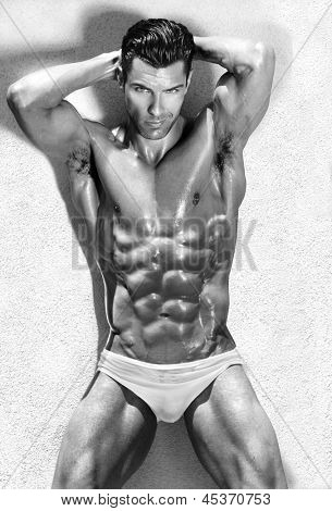 Body portrait of a beautiful muscular male model in sensual sexy pose