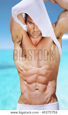 Vibrant fashion portrait of a sexy muscular fit man