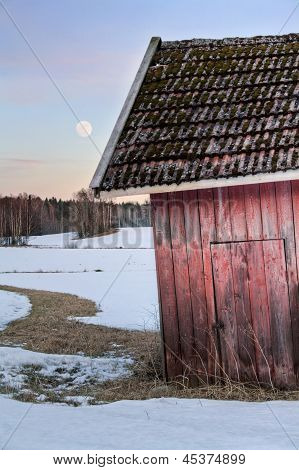 Old Red Barn In Snowy Landscape