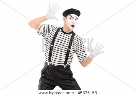 A male mime artist performing, isolated on white background