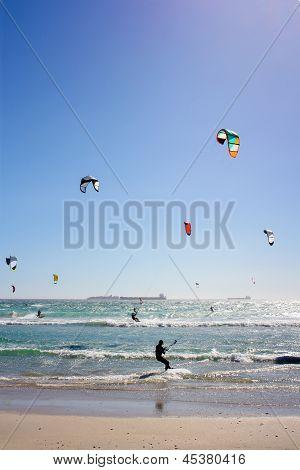 Many Kiteboarders In Water