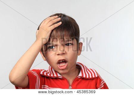 Boy Suffering from headache.