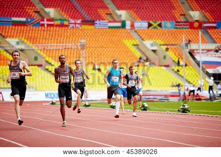 MOSCOW - JUN 11: Athletes run on track of Grand Sports Arena of Luzhniki Complex at International athletics competitions IAAF World Challenge Moscow Challenge, June 11, 2012, Moscow, Russia.