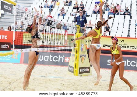 MOSCOW - JUNE 6: Brazil women play volleyball in Country Quota at tournament Grand Slam of beach volleyball 2012, on June 6, 2012 in Moscow, Russia.