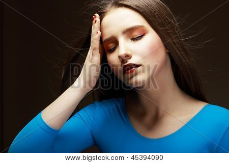 Distress. Woe. Upset Tired Woman Touching Her Forehead. Difficulties