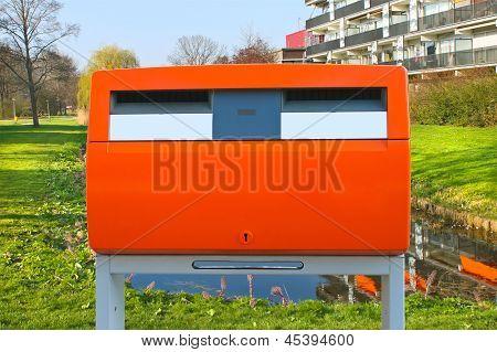 Dutch Public Orange Mailbox On A City Street. Netherlands