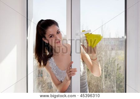 Girl Washes A Window