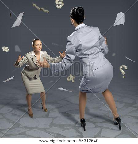 two businesswomen fighting as sumoist