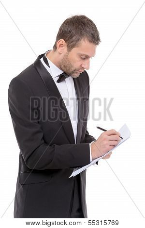 Handsome Man In A Bow Tie Writing Notes