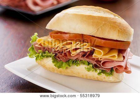 Brazilian Mortadela sandwich on a red background. poster