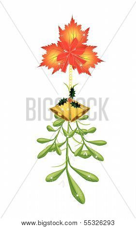 Green Mistletoe With A Red Bow And Golden Bells