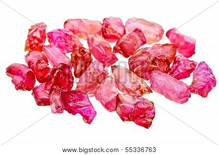 A pile of red uncut and rough ruby crystals. Treated with lead glass for clarity. poster