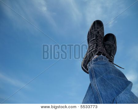 Blue Jeans And Sports Shoes