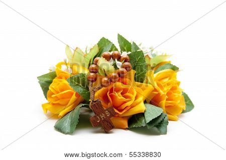 Orange Flowers with Green Sheets and  Rosary on white background