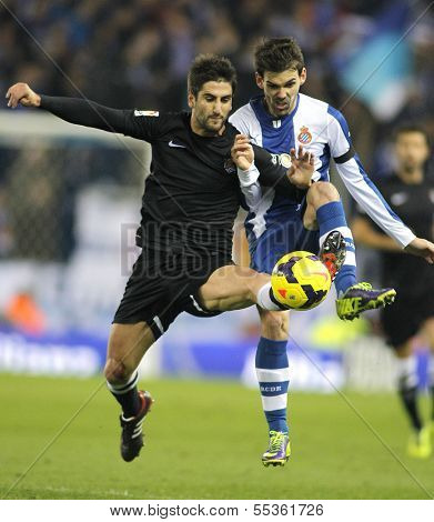 BARCELONA - NOV, 30: Markel Bergara(L) of Real Sociedad vies with Victor Alvarez(R) of Espanyol during a Spanish League match at the Estadi Cornella on November 30, 2013 in Barcelona, Spain