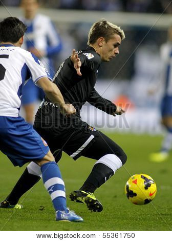 BARCELONA - NOV, 30: Antoine Griezmann of Real Sociedad in action during a Spanish League against RCD Espanyol match at the Estadi Cornella on November 30, 2013 in Barcelona, Spain