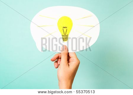 Hand showing white bubble. Yellow lightbulb. Smart think reinvent concept