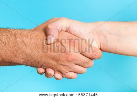 Cooperation Agreement Concept. Handshake. Two hands.
