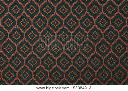 Material in geometric patterns, a colored textile background. poster