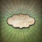 Vintage background with green blue and brown pastel colors sunbeams stripes and blank label poster