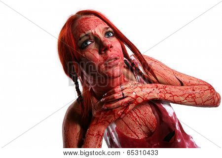 Beautiful red hair girl covered in blood