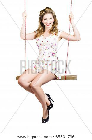 Beautiful Fifties Pin Up Girl Smiling On Swing