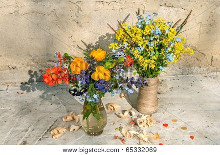 two yellow spring flowers still life bouquets