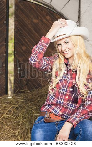 Sensual Blond Cowgirl Smiling Inside Of The Farm House. Vertical Image