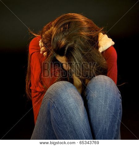 Desperate Woman Crying Holding Herself