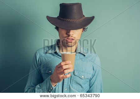 Cowboy Drinking Coffee