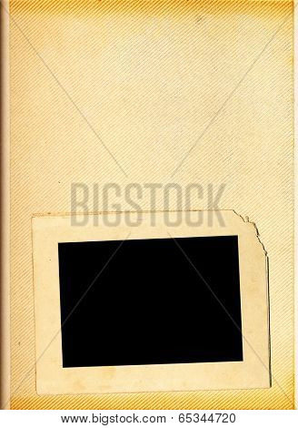 Blank page of a vintage photo album with one photo frame