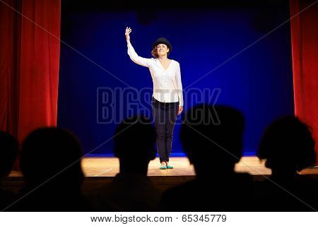 People Watching Actress On Theater Stage During Play