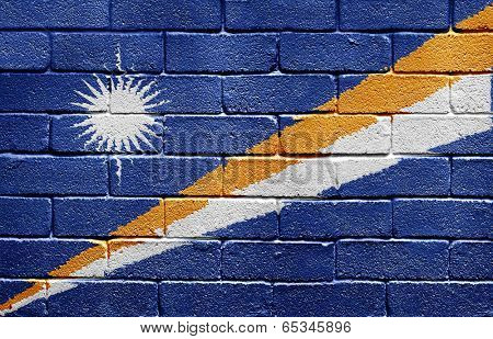 Flag of Marshall Islands painted onto a grunge brick wall