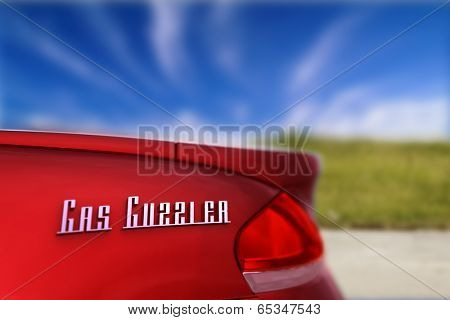 Gas guzzler - energy concept showing the rear of a car with