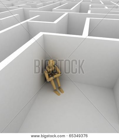 Depressed mannequin sitting in the corner of a big maze