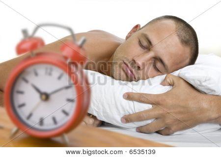 Man Asleep With Clock