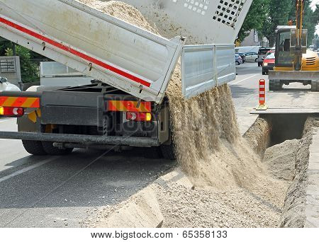 Truck Tipper During The Emptying Of The Gravel Road