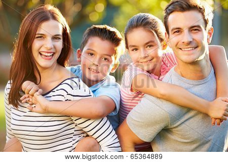 Outdoor Portrait Of Family Having Fun In Park