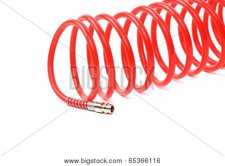 Red air hose. Close up.