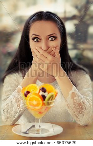 Surprised Young Woman with Fruit Salad Dessert