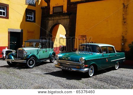 Funchal - April 25, 2014: Old timers in front of Sao Tiago fort in Funchal, Madeira