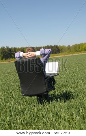 Man in chair on the field