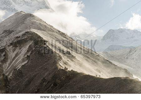 Hiking people on trail in Himalaya