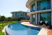 Modern villas at turkish Mediterranean resort Antalya Turkey poster