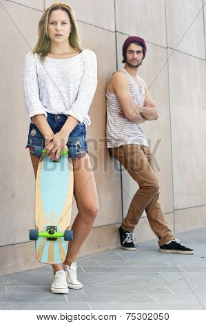 Young couple with tow strong personalities and individualism, representing the next generation.