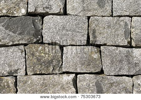 Wall with blocks of gray granite in the National Park of Adamello Brenta. Trentino Alto Adige Italy poster