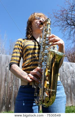 Woman Plays Saxophone Outdoors