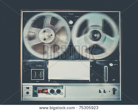 Vintage retro style photo with grain of reel to reel tape deck,